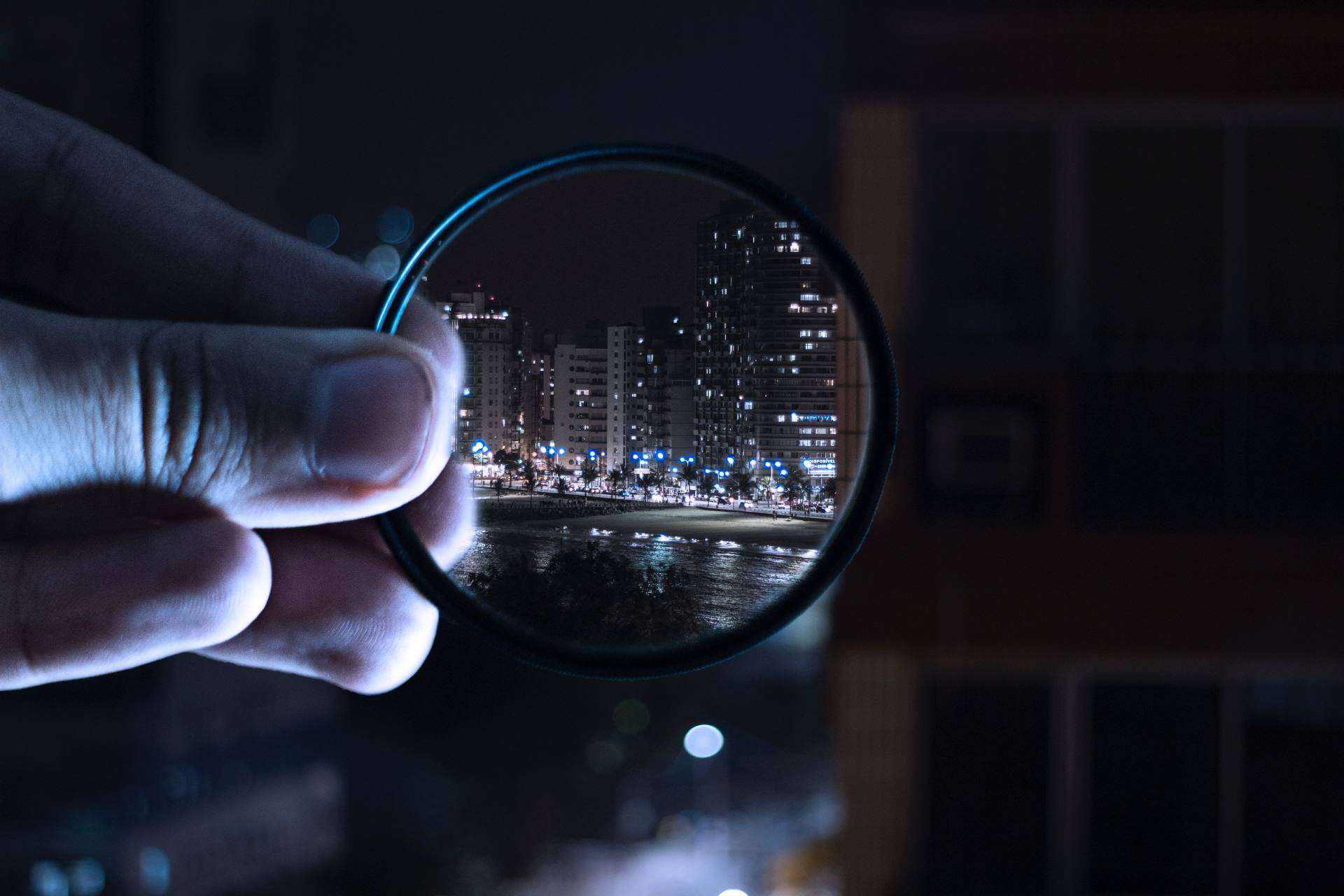 person-holding-magnifying-glass-712786 (1)